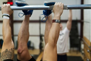 make sure that both feet touch the bar between your hands